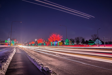 Christmas cityscape night with  car's blurred stoplights