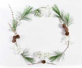 Frame pine tree branches cones Christmas holidays flat lay