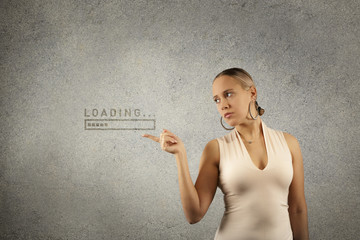 Young beautiful blond woman holds hands in shape of frame with drawn loading progress bar in copy space