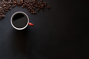 Top view of Cup of coffee with coffee beans with dark coffee wit