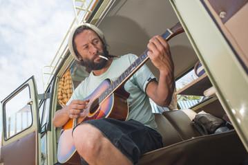 Man Plays Guitar in His Classic Combi Van.