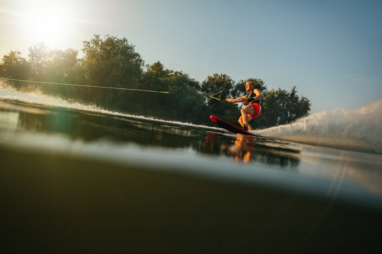 Athlete water skiing behind a boat