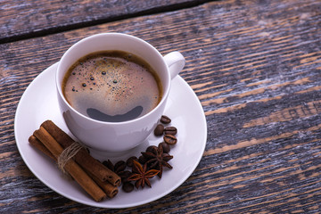 Coffee cup and biscuits, coffee beans on wooden background