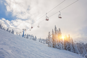 snowboarders on a ski lift