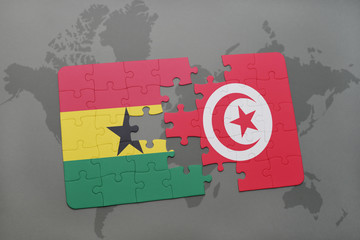 puzzle with the national flag of ghana and tunisia on a world map