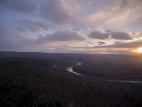 Scenic view of river at sunset