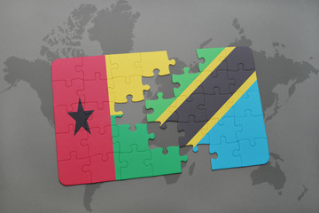 puzzle with the national flag of guinea bissau and tanzania on a world map