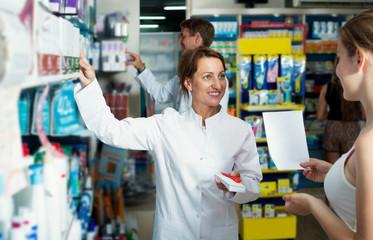 Female pharmacist in a white coat