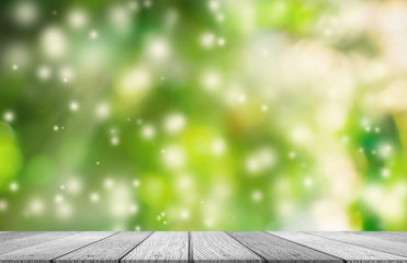 White wooden tabletop with fresh green nature and spring snow bokeh background sunlight use for products display or something.