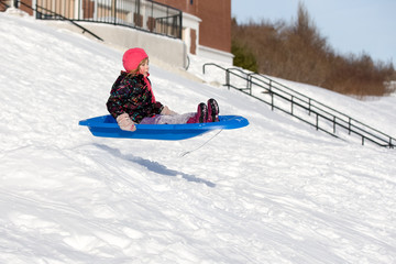 Sledding Girl Flying Down Hill