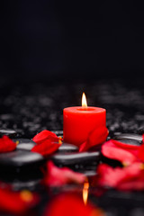 Wall Murals Spa Many rose petals with red candle and therapy stones