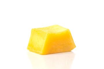 a delicious juicy yellow square piece of mango