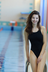 young beautiful swimmer woman smiling Full-length.