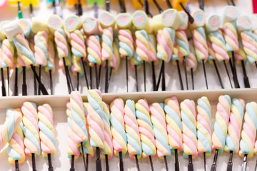 selective focus colorful marshmallows stick in department store