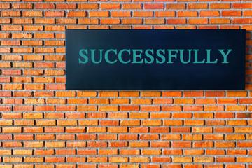 success text on brick wall