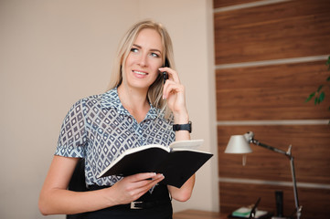 Attractive Young Businesswoman Working on the Business Documents