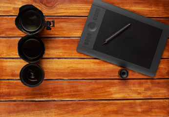 Photography dlsr lens on wood table