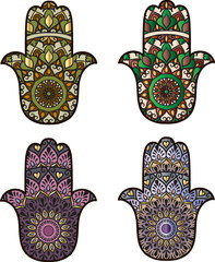 Two green and two violet hamsa on a white background