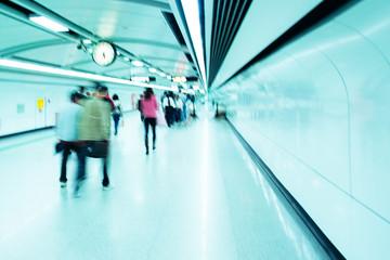 business people walk at subway station