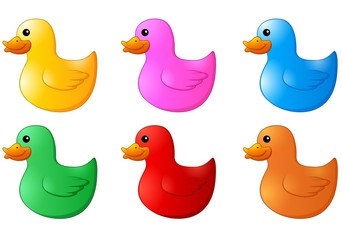 Several colors rubber ducks on white background