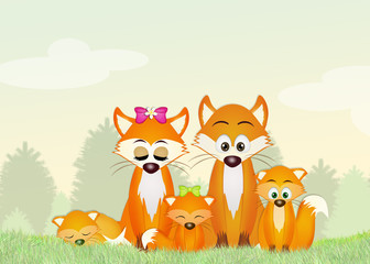 family of red foxes in the forest