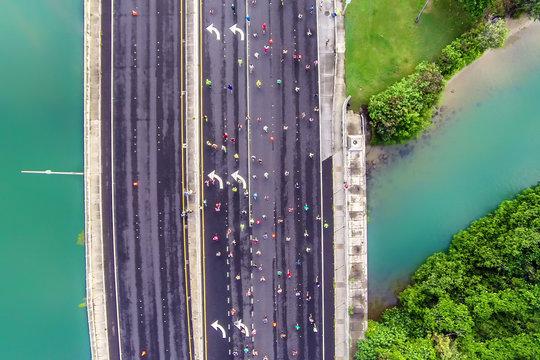 Top down aerial view of Honolulu Marathon participants crossing a bridge in Honolulu, Hawaii
