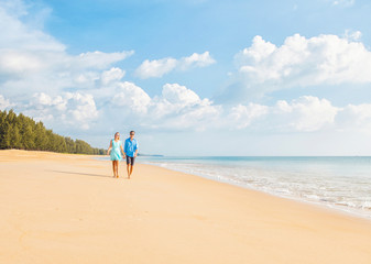 Couple walking on the beautiful beach. Vacation concept