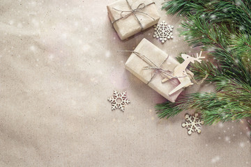 Christmas gifts,wooden decorations and branches on brown wrappin