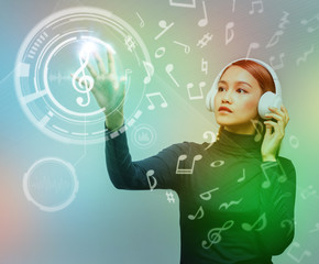 young woman wearing wireless headphone and music abstract