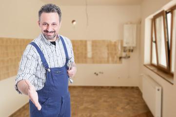 Friendly professional plumber doing handshake gesture