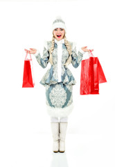 Lovely smiling Snow Maiden with gifts. Woman dressed in traditio