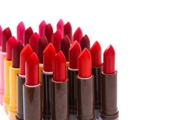 set of lipsticks red color on white background