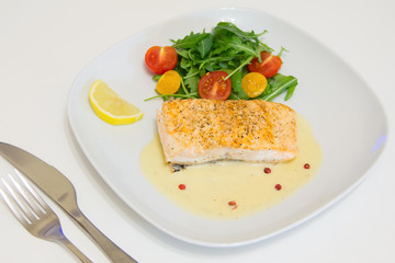 Grilled salmon steak with beurre blanc sauce, selective focus
