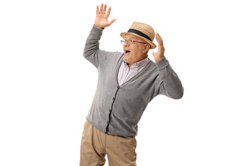 Elderly man being scared by something