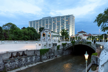 View on buildings and river crossing stadpark in vienna at sunset, austria