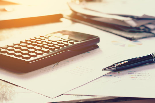 Close up business concept, Pen on summary report and calculator