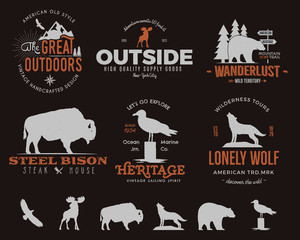 Wild animal badges set and outdoors activity insignias. Retro illustration of animal badges. Typography camping style. Vector animal badges logos with letterpress effect. Custom explorer quotes