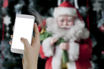 Hand holding smart phone photograph santa claus