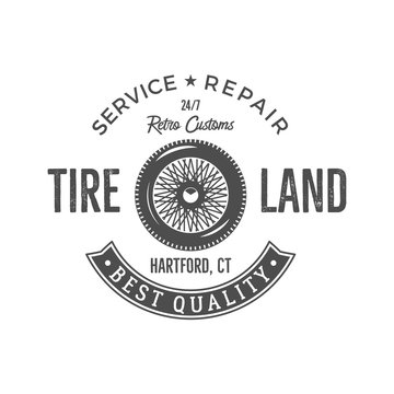 Vintage label design. Tire service emblem in monochrome retro style with old wheel and typography elements. Good for tee shirt , prints, car logo, repair station , badge etc