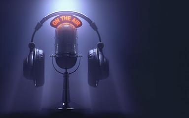 """Headset on the microphone with the """"On The Air"""" light on."""