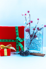 Fir branch and gift box on wooden background