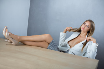 Sexy businesswoman on working place