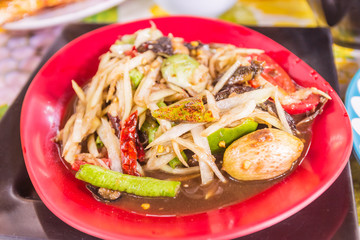 "Thai Northeast food called ""Papaya salad"". It is spicy and well-known menu all over the world"