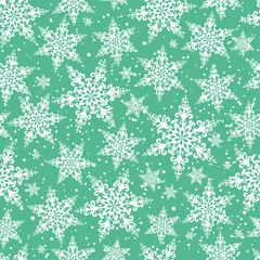 Seamless winter background of openwork snowflakes. Pattern.