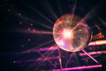Disco ball with bright rays, night party