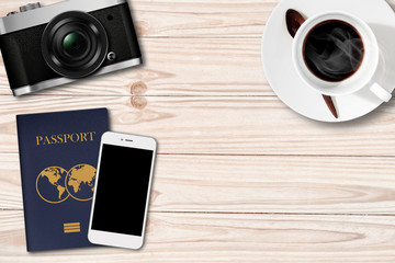 Retro camera,Smartphone and passport on Coffee Table