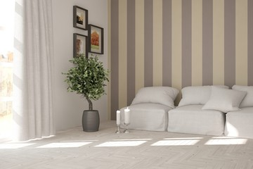 White living room interior with sofa