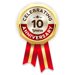 Red celebrating 10 years badge, rosette with gold border and ribbon