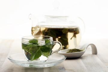 Tea. Mint Tea. Herbal tea. Mint leaf. Mint leaves. Tea in a glass cup, mint leaves, dried tea, sliced lime. herbs tea and mint leaves on a slate plate in a restaurant or teahouse tea room.