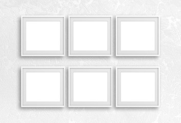 Collage of six blank frames on white textured wallpaper